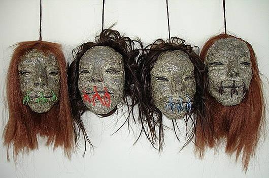 Shrunken Heads by Silvia Gold
