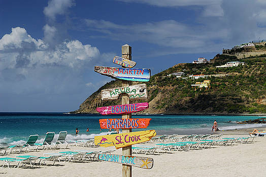 Reimar Gaertner - Signpost of Caribbean islands on the beach at St Maarten
