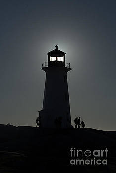 Dan Friend - silhouette of lighthouse with sun