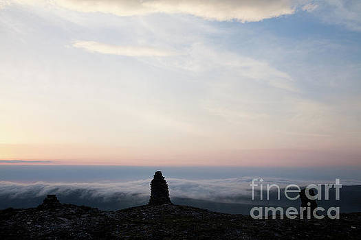 Silhouetted Stone Men by Gavin Dronfield