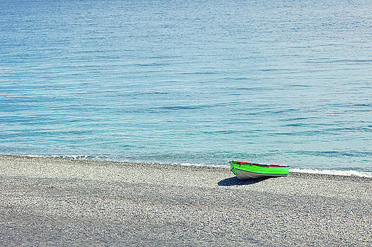 Simply a green boat by Alfio Finocchiaro