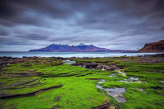 Singing Sands on Eigg with the Isle of Rum in the background by Neil Alexander