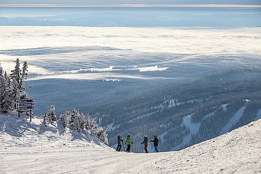 Skiers Above the Clouds by Sam Egan