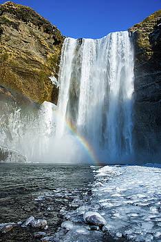 Skogafoss waterfall Iceland in winter by Matthias Hauser