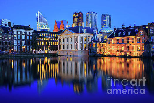 Skyline of The Hague at dusk during blue hour by IPics Photography