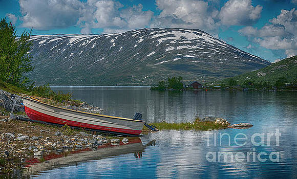 Small Boat On Trailer At Fjord In Norway by Compuinfoto