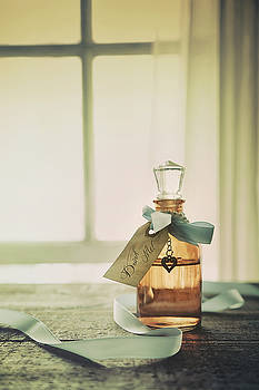 Sandra Cunningham - Small bottle with ribbon and tag