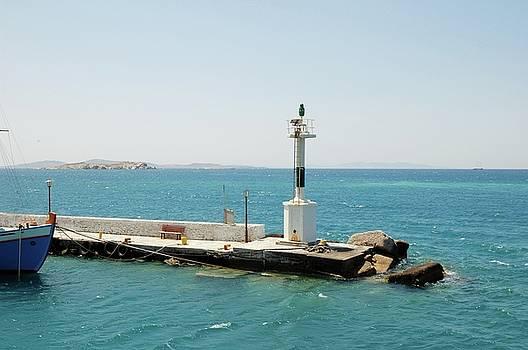 Small lighthouse among the Cycladic Islands by Yuri Hope