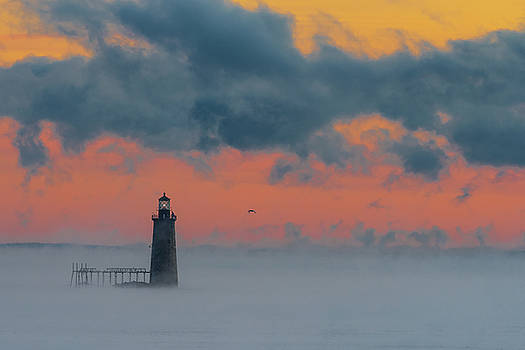 Smokey Sunrise at Ram Island Ledge Light by Jesse MacDonald
