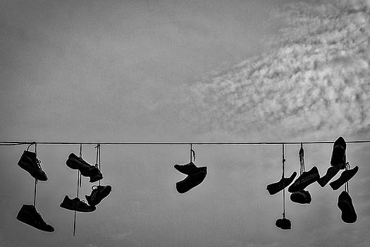Sneakers on a Wire by Stuart Litoff