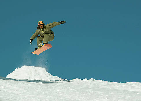 Snowboard jump by Victoria Savostianova