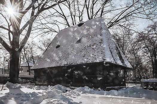 Snowing on a wonderful winter day at the Village Museum in Bucharest by Daniela Constantinescu