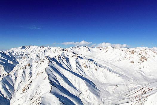 Snowy Peaks and Blue Skies by SR Green