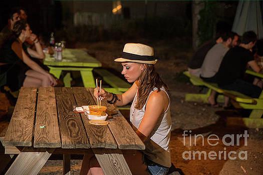 Herronstock Prints - Sparkling young Austin woman eats at an East Austin food truck trailer park