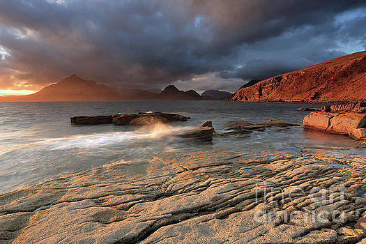 Splashing waves and the Cuillins at Sunset by Maria Gaellman