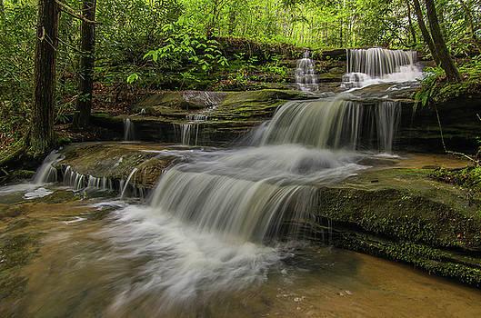 Spring waterfall. by Ulrich Burkhalter