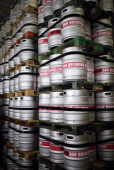 Reimar Gaertner - Stainless steel beer barrels stacked high at a brewery plant