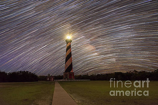 Star Trails behind Cape Hatteras Light  by Michael Ver Sprill