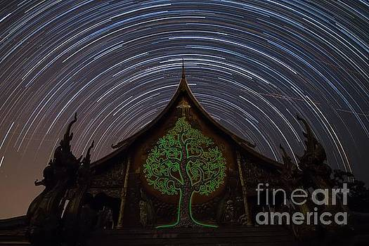 Star Trails in the night at temple by Tosporn Preede
