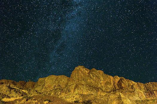 Starry Night Sky over Rocky Landscape by David Gn