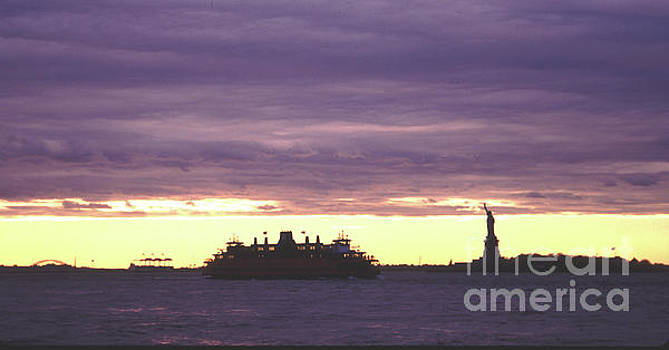 Statue of Liberty and Ferry Dramatic Sunset by Tom Wurl
