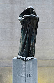 Reimar Gaertner - Statue of man in cape and hood leaning on a sword symbolizing Iv