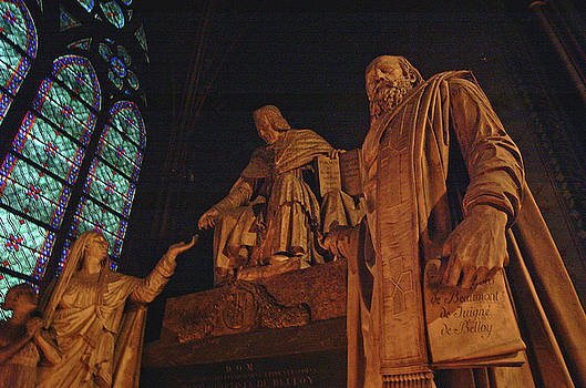 Statues inside Notre Dame in Paris France by Paul Pobiak