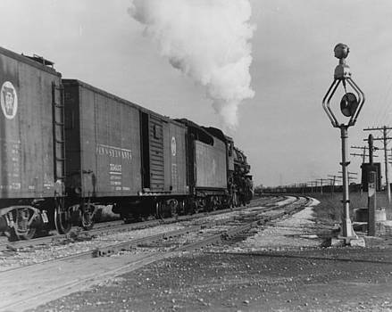 Chicago and North Western Historical Society - Steam Engine Carrying Freight Past Railroad Signal