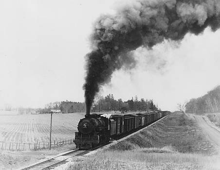 Chicago and North Western Historical Society - Steam Engine Hauls Freight Through Country