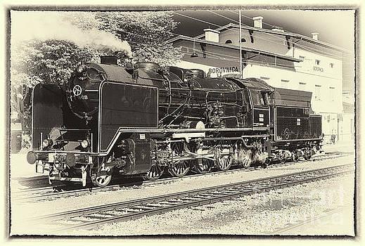 Steam engine in sepia, framed by Vyacheslav Isaev