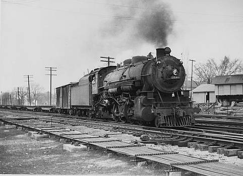 Chicago and North Western Historical Society - Steam Engine Lugging Freight Through Ames - 1941