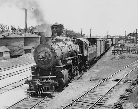 Chicago and North Western Historical Society - Steam Engine Lugging Freight Through Ames