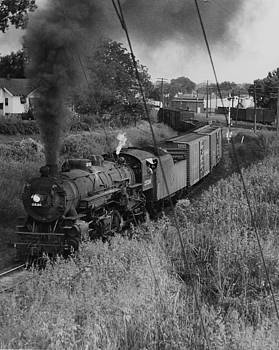 Chicago and North Western Historical Society - Steam Engine Lugging Freight Through Iowa - 1954
