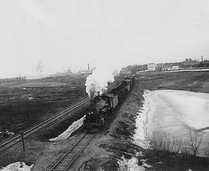 Chicago and North Western Historical Society - Steam Locomotive Chugging Away from Community