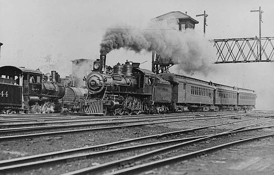 Chicago and North Western Historical Society - Steam Locomotive Chugging Down Track