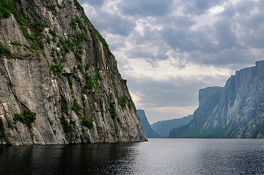 Reimar Gaertner - Steep Igneous rock wall at Western Brook Pond inland fjord at Gr