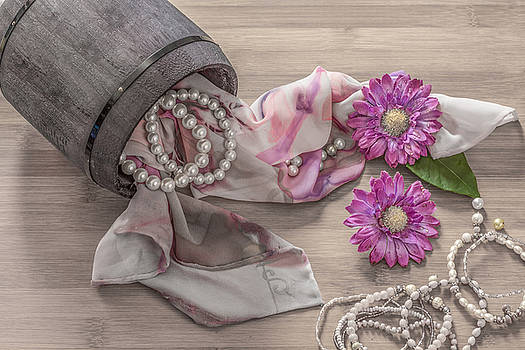 Still life details, scarf and pearls in retro vintage wooden box by Julian Popov