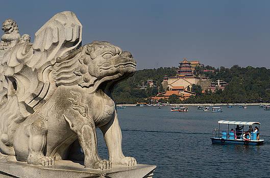 Reimar Gaertner - Stone lion on 17 Arch Bridge over Kunming Lake with paddle boate