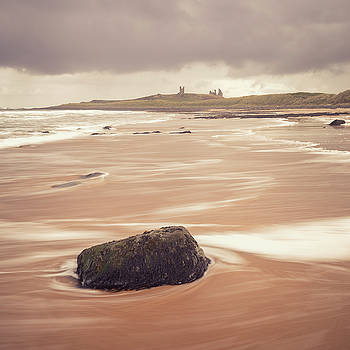 Stone on the beach - Dunstanburgh castle by Kelvin Trundle
