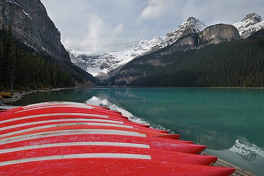 Reimar Gaertner - Stored red canoes at Lake Louise Banff National Park Alberta