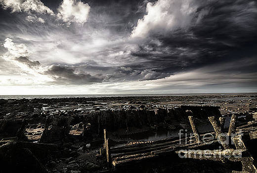 Storm clouds over beached shipwreck by Simon Bratt Photography LRPS