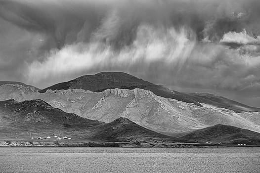 Storm clouds over mountain by Hitendra SINKAR