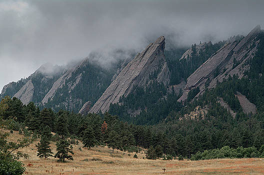 Storm Clouds Over the Flatirons by Alan Bland