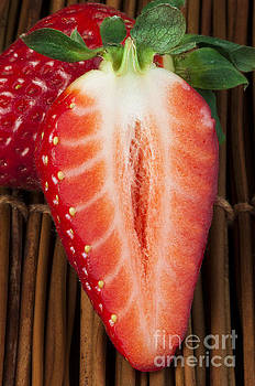 Strawberries on wooden base by Deyan Georgiev
