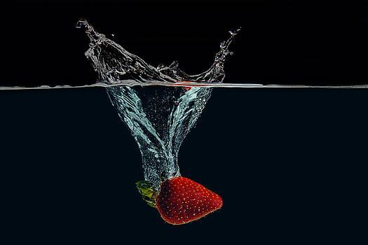 Strawberry falls in Water by Baptiste De Izarra