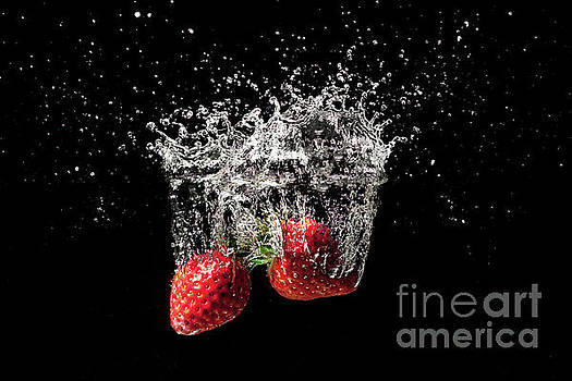 Strawberry fruit big splash into water by Simon Bratt Photography LRPS