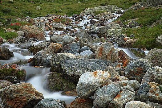 Stream in the mountains at the Sustenpass, Switzerland by Martin Wackenhut