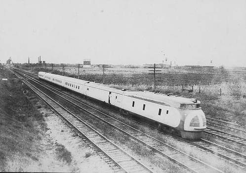 Chicago and North Western Historical Society - Streamlined Diesel Locomotive Carrying Passengers