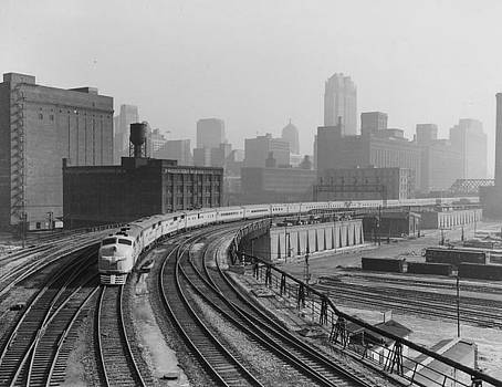 Chicago and North Western Historical Society - Streamlined Diesel Locomotive Passes Through Major City