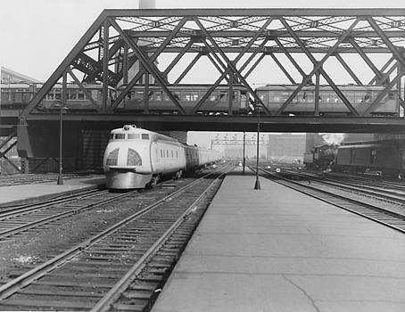 Chicago and North Western Historical Society - Streamlined Diesel Locomotive Passes Under Bridge
